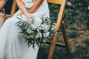 bride holding her wedding bouquet of white flowers